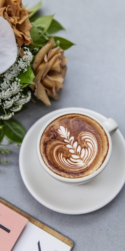 A cappuccino with latte art at Quick Brown Fox Eatery